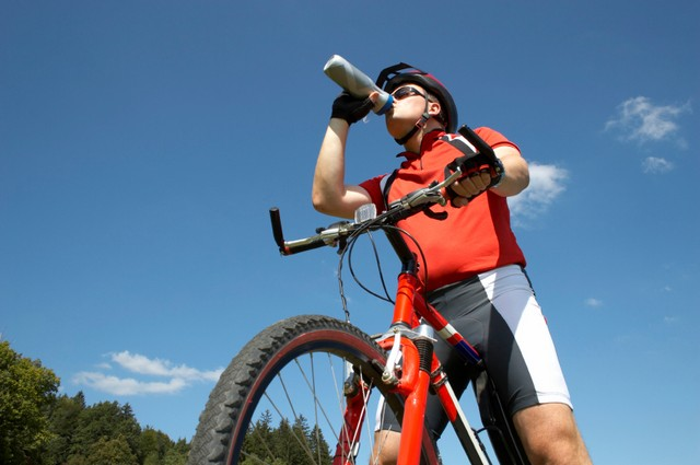 Mountain biker on mountain bike in scenic shoot. Nice vivid colors. Model release included.